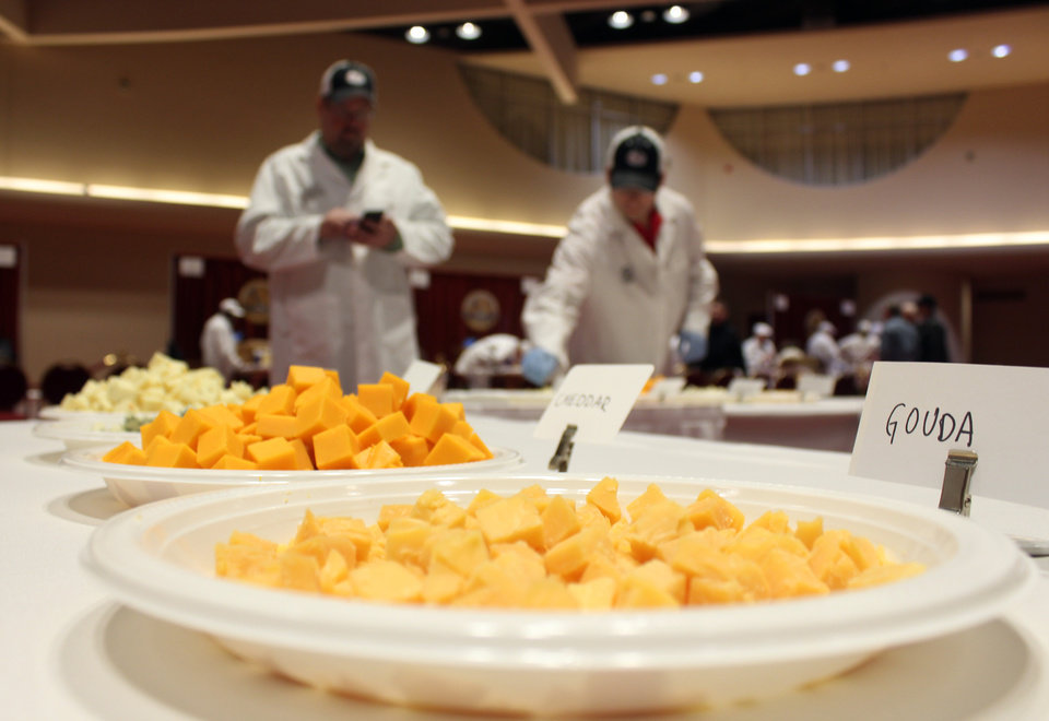 Photo - Free samples of cheese sit out for spectators during the first day of judging for 2014 World Championship Cheese Contest Tuesday, March 18, 2014, in Madison, Wis. Entries in the contest reached a new record this year, growing five percent to more than 2,600 entries from 22 nations around the world. (AP Photo/Carrie Antlfinger)