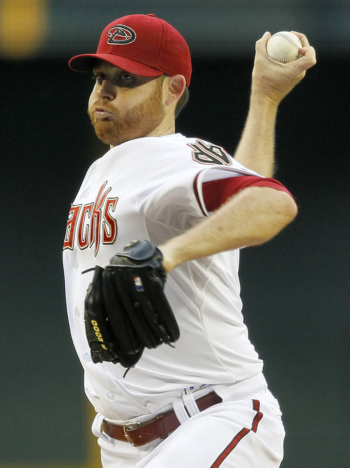 Photo -   Arizona Diamondbacks pitcher Ian Kennedy winds up against the St. Louis Cardinals during the first inning of a baseball game Tuesday, May 8, 2012, in Phoenix. (AP Photo/Matt York)