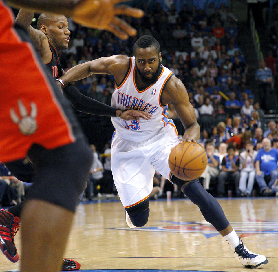 Oklahoma City's James Harden dribbles past Toronto's Sonny Weems during their NBA basketball game at the OKC Arena in downtown Oklahoma City on Sunday, March 20, 2011. Photo by John Clanton, The Oklahoman