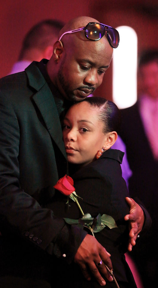 Photo - Dantae Sewell and daughter, Lani, 10, dance during the Midwest City Parks and Recreation Department's annual Daddy-Daughter Dance.