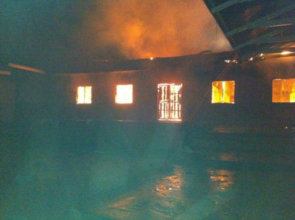 A fire threatened to destroy a secondary school girls' dormitory in Chimala, Tanzania, during an  Oklahoma Christian University student mission trip in May. Photo provided <strong></strong>