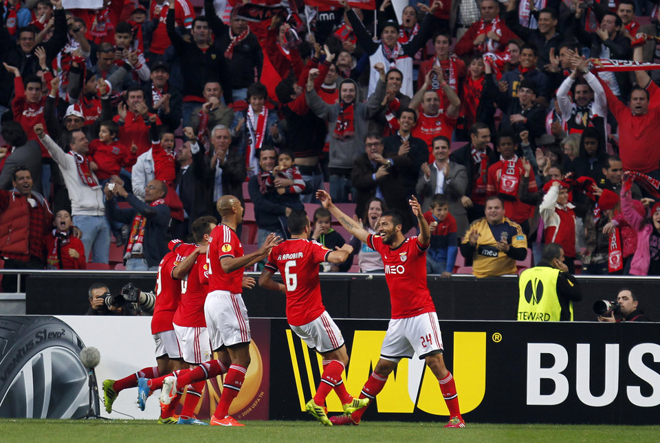 Photo - Benfica's Ezequiel Garay, right, from Argentina, celebrates with teammates after scoring the opening goal against Tottenham during the Europa League, round of 16, second leg soccer match between Benfica and Tottenham at Benfica's Luz stadium, in Lisbon, Thursday, March 20, 2014. (AP Photo/Francisco Seco)