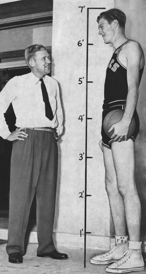 Photo - Oklahoma A&M coach Hank Iba and Bob Kurland pose for a photo in 1942. OKLAHOMAN ARCHIVE PHOTO  UNKNOWN