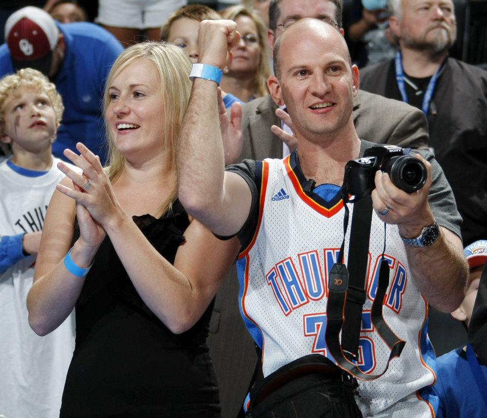 Photo - Newlywed Thunder fans from Australia, Magda Bartucciotto, left, and Andrew Bartucciotto, cheer during player introductions before the NBA basketball game between the Minnesota Timberwolves and the Oklahoma City Thunder at the Oklahoma City Arena, Monday, November 22, 2010, in Oklahoma City. The couple scheduled a trip to Oklahoma City to see the Thunder play as part of their honeymoon in the United States.. Photo by Nate Billings, The Oklahoman