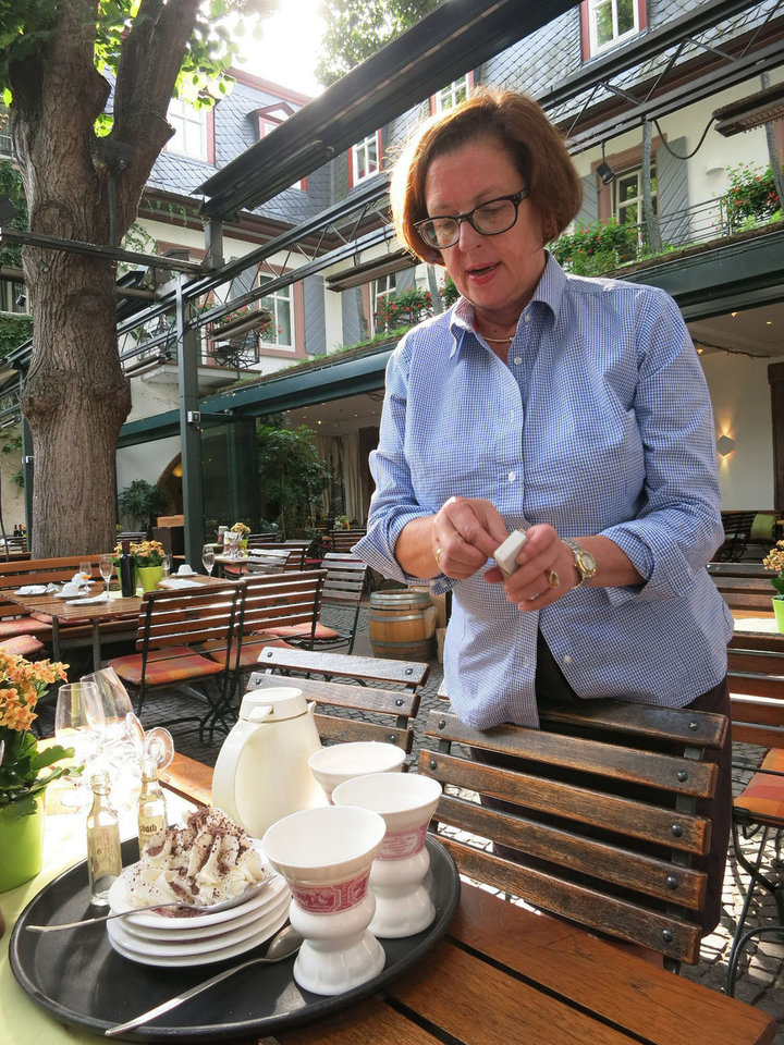 Photo -  Susanne Breuer demonstrates the proper way to prepare a Rudesheimer coffee. Photo courtesy of Jerry Farlow.