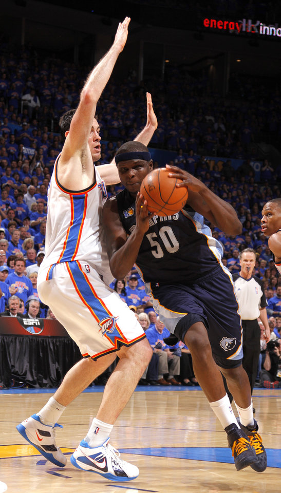 Photo - Oklahoma City's Nick Collison (4) defends against Zach Randolph (50) of Memphis during game 7 of the NBA basketball Western Conference semifinals between the Memphis Grizzlies and the Oklahoma City Thunder at the OKC Arena in Oklahoma City, Sunday, May 15, 2011. Photo by Sarah Phipps, The Oklahoman