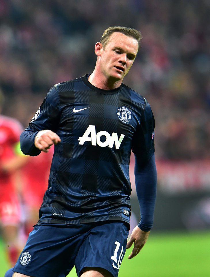 Photo - Manchester United's Wayne Rooney looks down during the Champions League quarterfinal second leg soccer match between Bayern Munich and Manchester United in the Allianz Arena in Munich, Germany, Wednesday, April 9, 2014. Munich defeated Manchester by 3:1. (AP Photo/Kerstin Joensson)