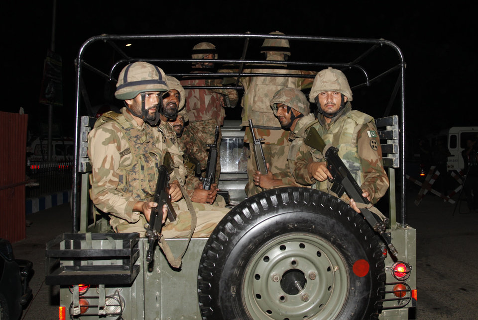 Photo - Pakistani troops arrive at Jinnah International Airport following an attack by unknown gunmen disguised as police guards who stormed a terminal used for VIPs and cargo, Sunday night, June 8, 2014, in Karachi, Pakistan. The airport attack still was ongoing early Monday in Karachi, a sprawling port city on the southern coast of Pakistan, although officials said all the passengers had been evacuated. (AP Photo/Shakil Adil)