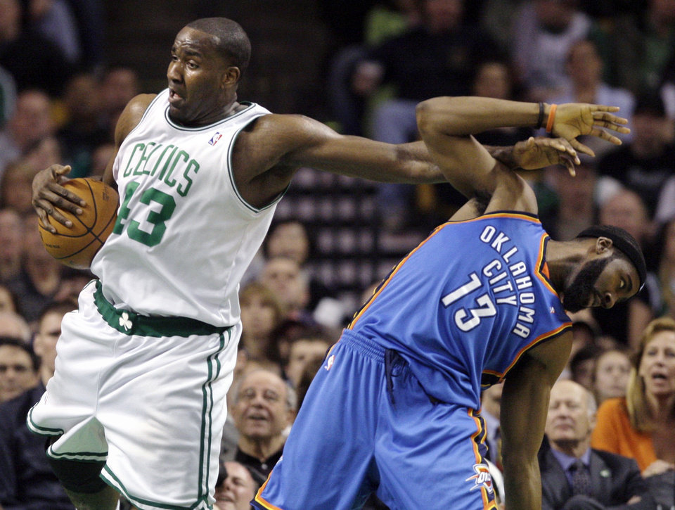 Boston center Kendrick Perkins, left, tangles with Oklahoma City guard James Harden as he grabs a rebound during the first half of game this past season in Boston.  AP photo