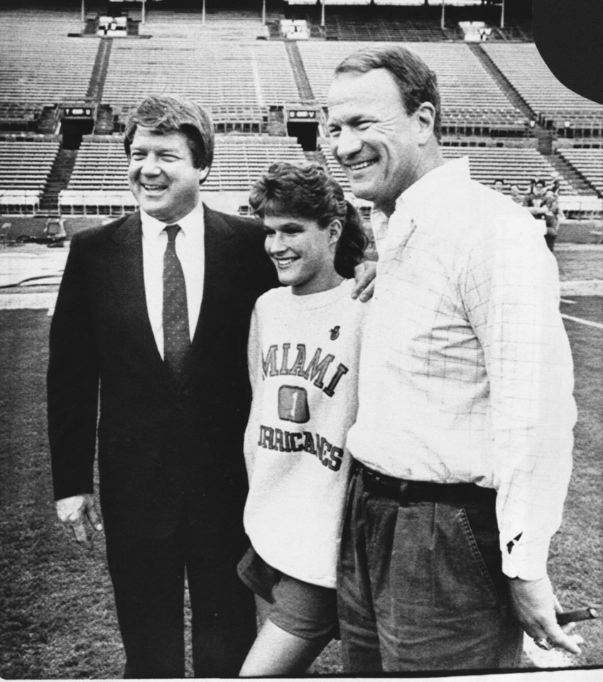 <strong>1987: Switzer and Jimmy Johnson</strong><br>  In this photo from late December 1987, Switzer and Jimmy Johnson pose for a photo with Switzer's daughter, Kathy. PHOTO BY DAVID McDANIEL, The Oklahoman Archive
