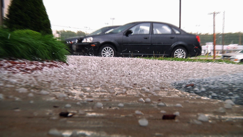 Photo - In this image taken from video, large hail stones are seen on the ground after a thunderstorm passed through Poplar Bluff, Mo., Wednesday, April 27, 2011. Powerful storms continue to push through the nation's midsection raising river levels to dangerous heights. (AP Photo/Robert Ray)