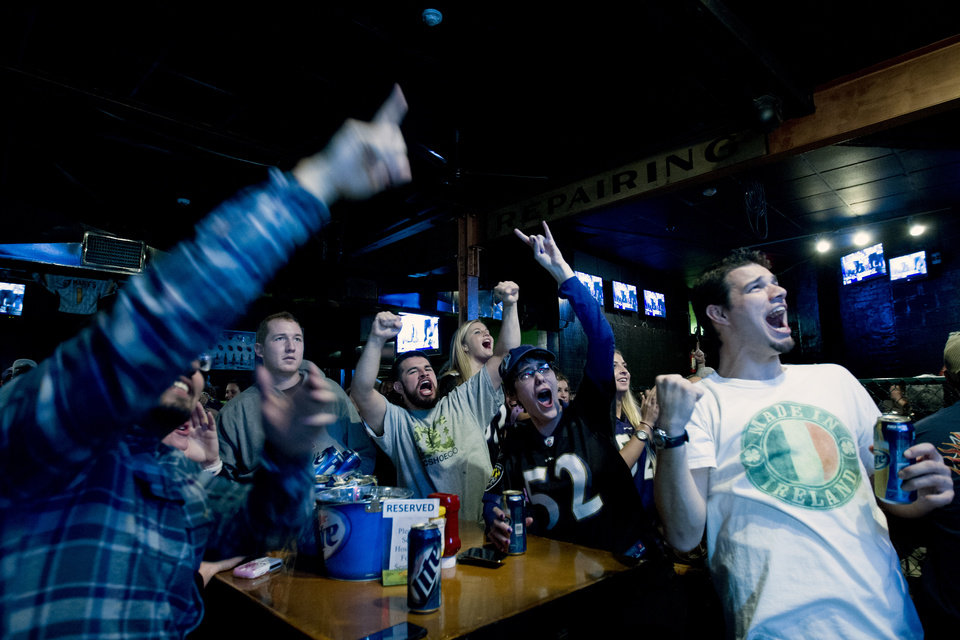 Photo - Baltimore Ravens fans celebrates after their team score the first touchdown against the San Francisco 49ers, at local pub in Baltimore Md. on Sunday Feb. 3, 2013. (AP Photo/Jose Luis Magana)