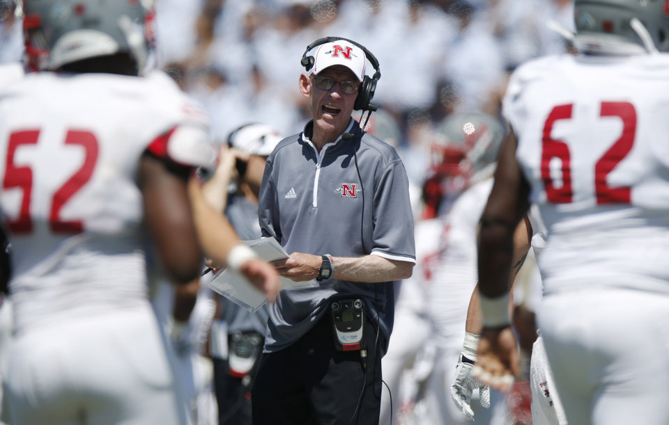 Photo - Nicholls State head coach Charlie Stubbs, center, directs his players against Air Force in the second quarter of an NCAA college football game at Air Force Academy, Colo., on Saturday, Aug. 30, 2014. (AP Photo/David Zalubowski)