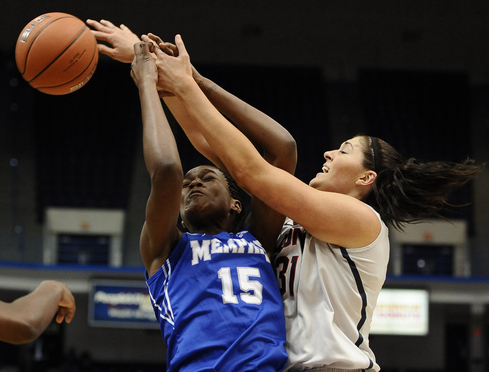 Photo - Memphis' Pa'Sonna Hope, left, and Connecticut's Stefanie Dolson, right, vie for a rebound during the first half of an NCAA college basketball game, Wednesday, Jan. 22, 2014, in Hartford, Conn. (AP Photo/Jessica Hill)