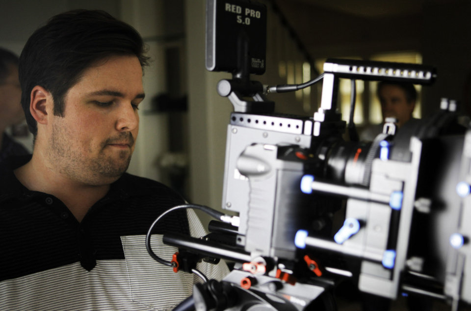 Photo - Brian Cates, of Oklahoma City, configures the camera that will be used to film