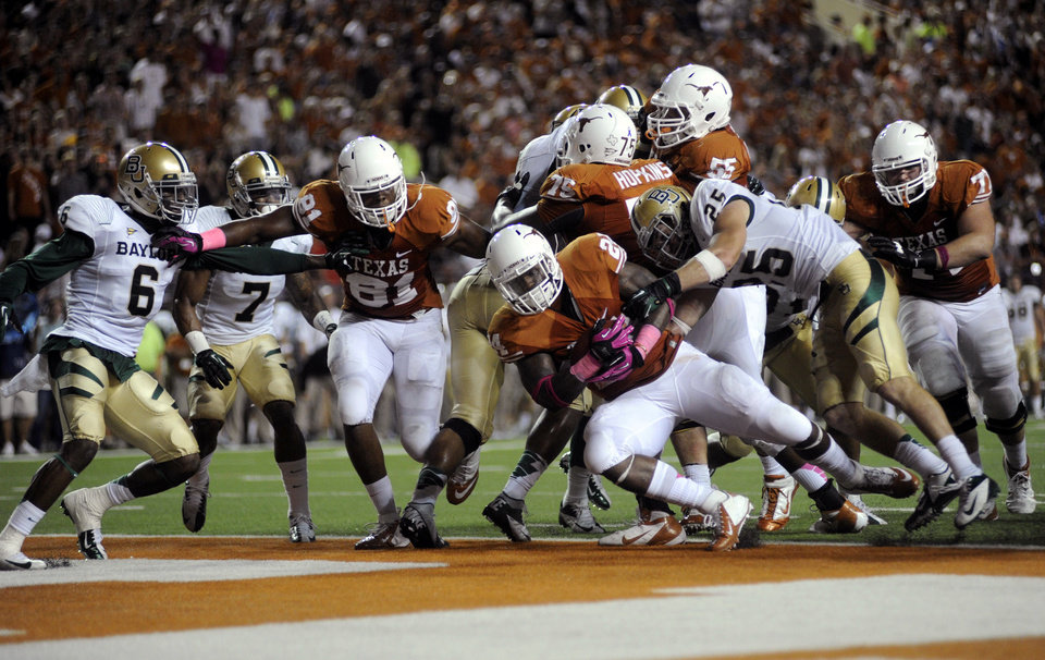 Photo -   Texas running back Joe Bergeron (24) scores a touchdown during the second quarter of an NCAA college football game against Baylor, Saturday, Oct. 20, 2012, in Austin, Texas. (AP Photo,The Daily Texan, Elisabeth Dillon)