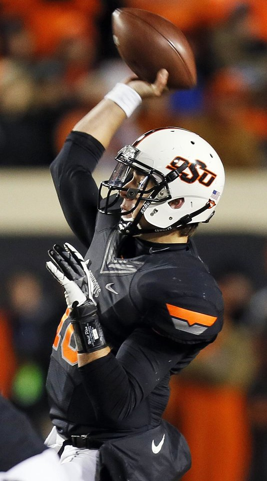 Oklahoma State's Clint Chelf (10) throws a pass during a college football game between the Oklahoma State University Cowboys (OSU) and the Baylor University Bears (BU) at Boone Pickens Stadium in Stillwater, Okla., Saturday, Nov. 23, 2013. OSU won, 49-17. Photo by Nate Billings, The Oklahoman