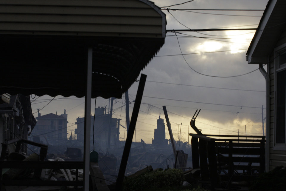 Photo -   Damage caused by a fire at Breezy Point is shown Tuesday, Oct. 30, 2012, in the aftermath of superstorm Sandy, in the New York City borough of Queens. The fire destroyed between 80 and 100 houses Monday night in the flooded neighborhood. (AP Photo/Frank Franklin II)