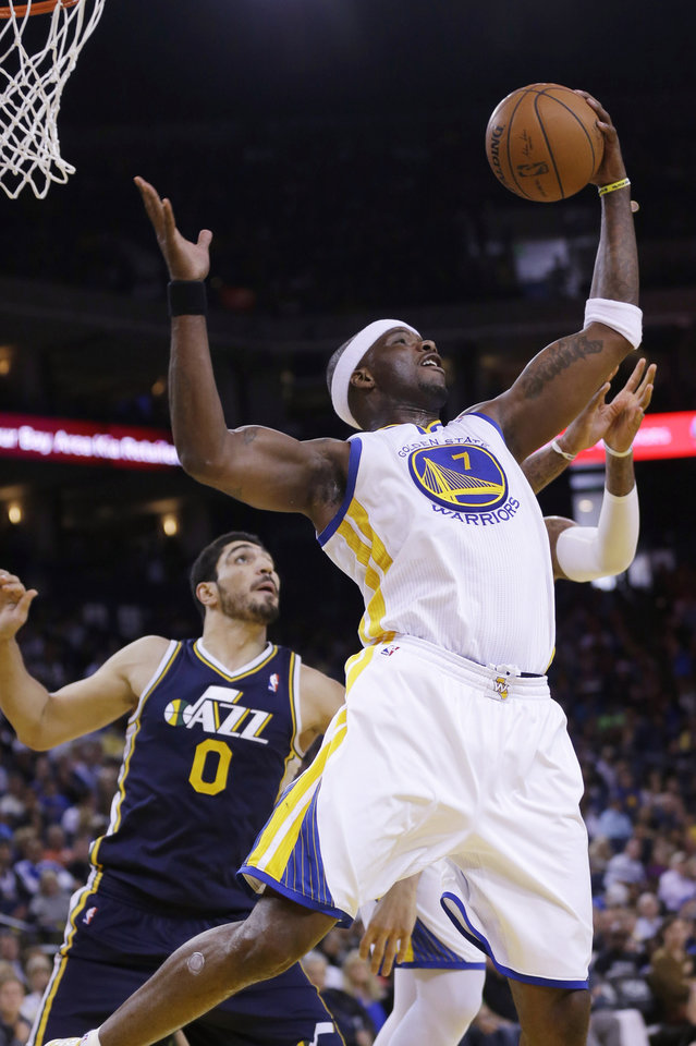 Photo - Golden State Warriors center Jermaine O'Neal (7) grabs a rebound in front of Utah Jazz center Enes Kanter (0) during the first half of an NBA basketball game Sunday, April 6, 2014, in Oakland, Calif. (AP Photo/Marcio Jose Sanchez)