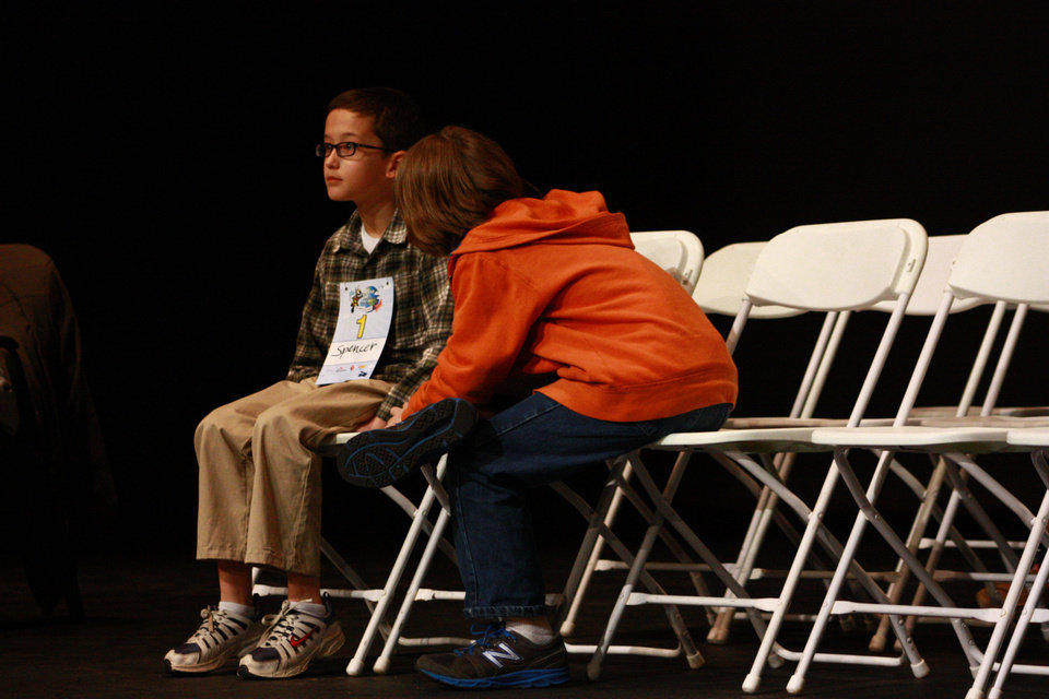 Spencer Farthing, fifth-grader from Bryant Elementary, Oklahoma Cty, left, takes a breather from the intense competition with Seth Riden, sixth-grader from Willard Elementary School in Ada.  <strong>By Lynette Lobban, For The Oklahoman</strong>