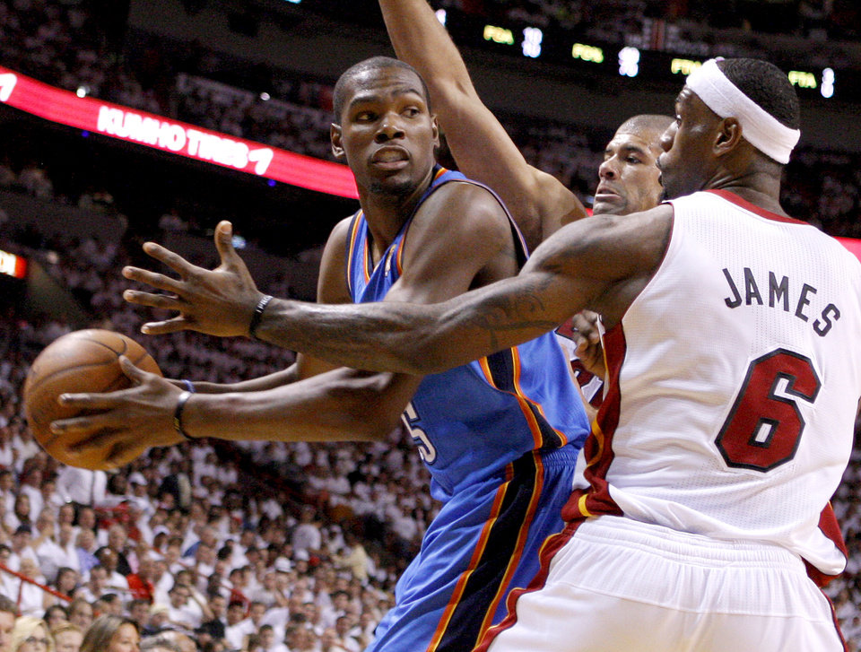 Oklahoma City's Kevin Durant (35) looks to pass around Miami's Shane Battier, center, and Miami's LeBron James (6) during Game 4 of the NBA Finals between the Oklahoma City Thunder and the Miami Heat at American Airlines Arena, Tuesday, June 19, 2012. Photo by Bryan Terry, The Oklahoman