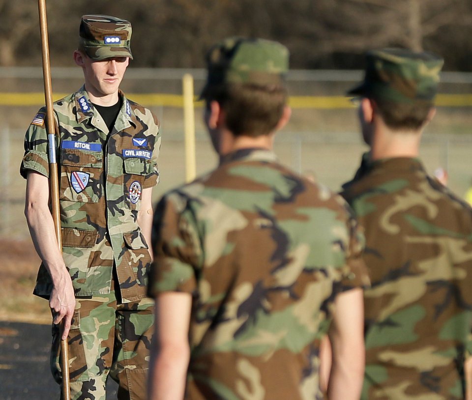 Cadet Capt. Caleb Ritchie stands in front of cadets in formation at the beginning of a meeting of the Edmond Composite Squadron of the Civil Air Patrol. Photo by Nate Billings, The Oklahoman <strong>NATE BILLINGS - NATE BILLINGS</strong>