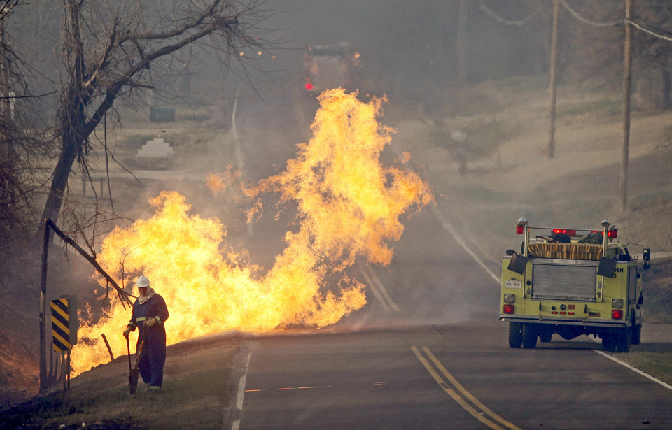 Photo - WILDFIRES / FIRES: Flames leap out of a broken gas line in Midwest City, Thursday, April 9, 2009. Photo by Bryan Terry, The Oklahoman ORG XMIT: KOD