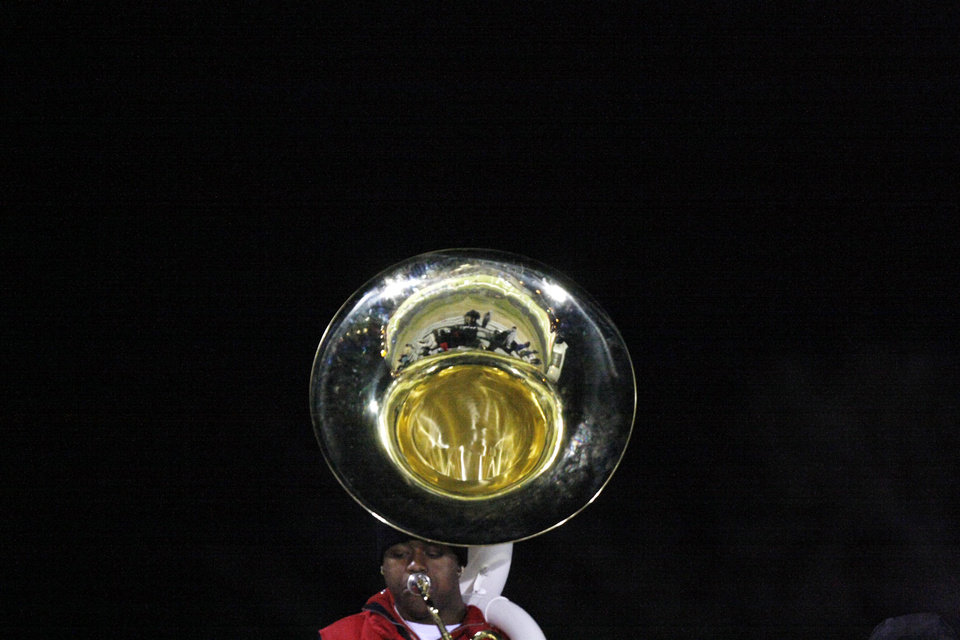 A Millwood tuba player stands at the top of the stadium bleachers during the Class 2A State semifinal football game between Millwood High School and Kingfisher High School on Saturday, Dec. 5, 2009, in Yukon, Okla. 
