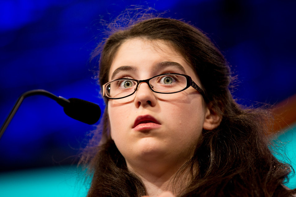 "Photo - Mary Jo Johnson, 12, of Dayton, Ohio, reacts as she correctly spells her word ""indigenous"" during the 2015 Scripps National Spelling Bee, Wednesday, May 27, 2015, in Oxon Hill, Md. (AP Photo/Andrew Harnik)"