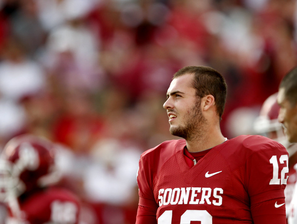 Photo - Landry Jones stands on the field before the college football game between the University of Oklahoma Sooners (OU) and the Iowa State Cyclones (ISU) at the Gaylord Family-Oklahoma Memorial Stadium on Saturday, Oct. 16, 2010, in Norman, Okla.   Photo by Bryan Terry, The Oklahoman
