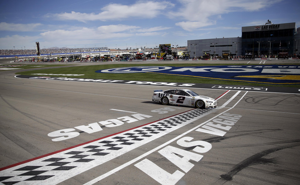 Photo - Brad Keselowski (2) passes the finish line to win a NASCAR Sprint Cup Series auto race Sunday, March 9, 2014, in Las Vegas. (AP Photo/Isaac Brekken)
