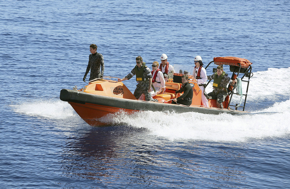 Photo - In this April 7, 2014 photo provided by the Australian Defense Force a fast response craft manned by members from the Australian Defense's ship Ocean Shield is deployed to scan the water for debris of missing Malaysia Airlines Flight 370 in the southern Indian Ocean. Up to 14 planes and as many ships were focusing on a single search area covering 77, 580 square kilometers (29,954 square miles) of ocean, 2,270 kilometers (1,400 miles) northwest of the Australian west coast city of Perth, Australia. (AP Photo/Australia Defense Force, LSIS Bradley Darvill) EDITORIAL USE ONLY