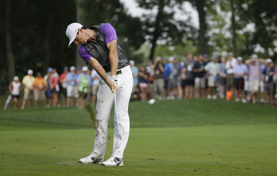 Photo - Rory McIlroy, of Northern Ireland, hits from the fairway on the 12th hole during the final round of the PGA Championship golf tournament at Valhalla Golf Club on Sunday, Aug. 10, 2014, in Louisville, Ky. (AP Photo/Jeff Roberson)