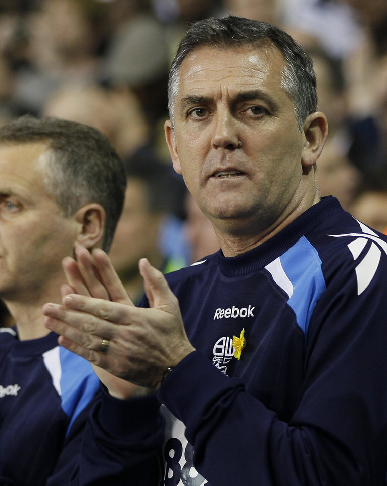 FILE This Tuesday, March 27, 2012 file photo shows Bolton\'s manager Owen Coyle applauding for Fabrice Muamba ahead of the replay of the English FA Cup soccer match quarter final between Tottenham Hotspur and Bolton Wanderers at White Hart Lane Stadium in London. Once hailed as one of Britain's most promising young managers, Owen Coyle was fired by second-tier Bolton on Tuesday Oct. 9, 2012 to complete his fall from grace after the club's relegation from the Premier League. In its first season out of the top flight since 2001, Bolton has won just three of its 10 matches to lie in 18th place in the 24-team League Championship. (AP Photo/Kirsty Wigglesworth, File)