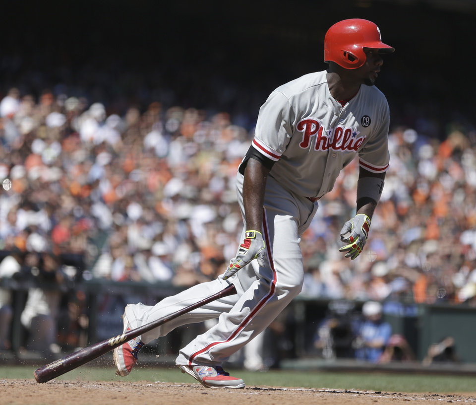 Photo - Philadelphia Phillies' Ryan Howard drops his bat after hitting a two-run single off San Francisco Giants' Tim Hudson in the fifth inning of a baseball game Saturday, Aug. 16, 2014, in San Francisco. (AP Photo/Ben Margot)