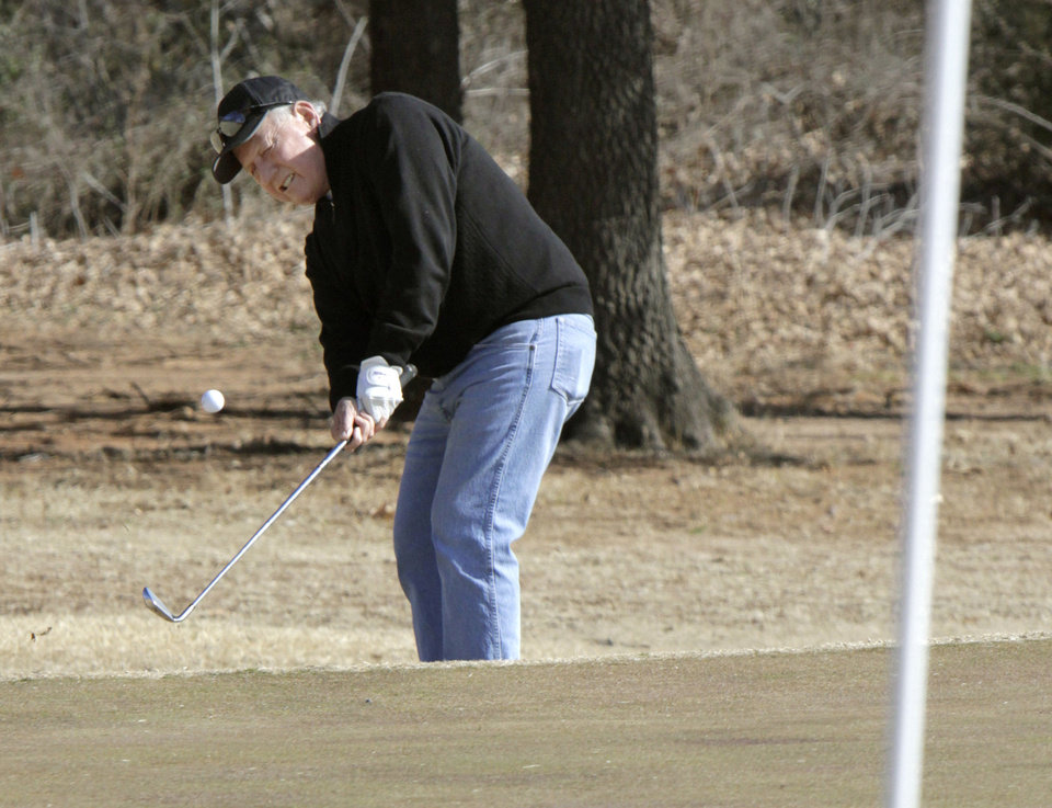 Jim Towry chips a shot toward the green during the 14th annual two-man Ironman golf tournament at KickingBird Golf Course in Edmond, OK, Saturday, Jan. 28, 2012. By Paul Hellstern, The Oklahoman