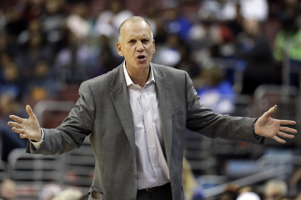 Photo - Philadelphia 76ers head coach Doug Collins reacts to a call in the first half of an NBA basketball game against the Detroit Pistons, Monday, Dec. 10, 2012, in Philadelphia. (AP Photo/Matt Slocum)