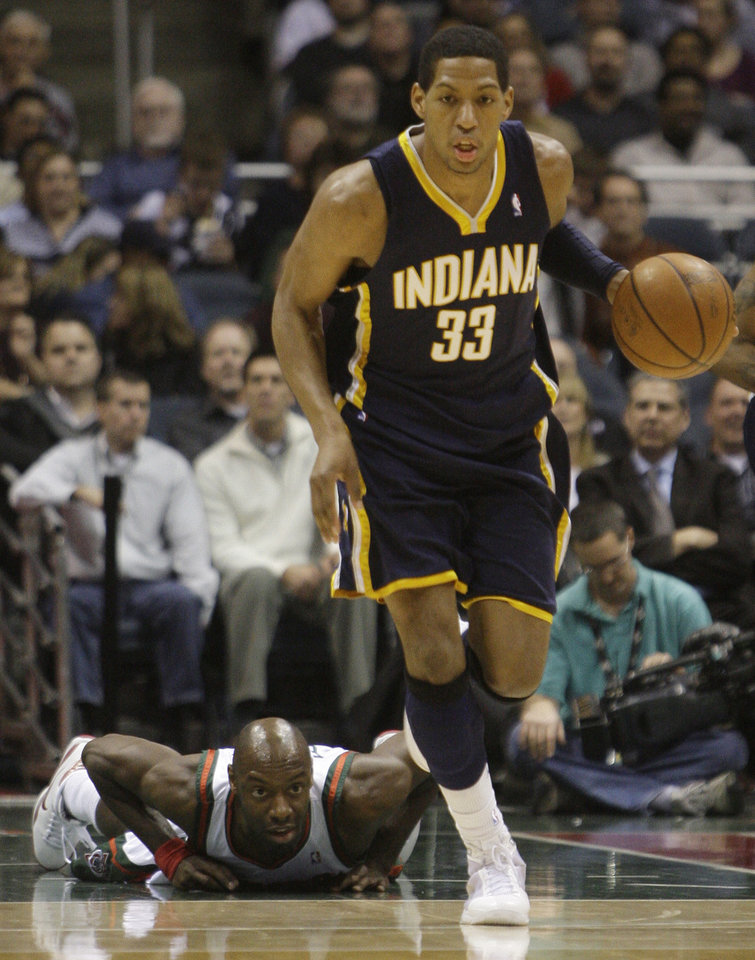 Photo - Milwaukee Bucks' Francisco elson watches Indiana Pacers' Danny Granger get control of the ball during the first half of an NBA basketball game Wednesday, Feb. 11, 2009, in Milwaukee. (AP Photo/Morry Gash)  ORG XMIT: WIMG104