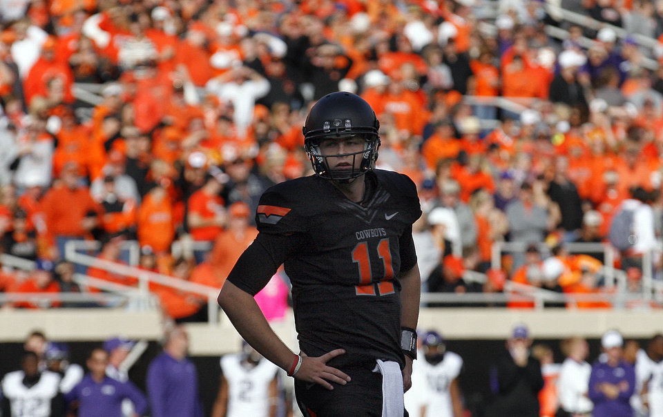 Oklahoma State's Wes Lunt (11) waits for a call during a college football game between Oklahoma State University (OSU) and Texas Christian University (TCU) at Boone Pickens Stadium in Stillwater, Okla., Saturday, Oct. 27, 2012. Photo by Sarah Phipps, The Oklahoman