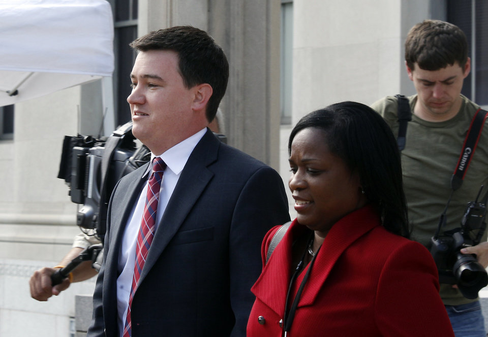 Photo -   Matthew L. Nelson is escorted from the Federal Courthouse in Greensboro, N.C., Wednesday May 2, 2012 after testifying in the trial of former Sen. John Edwards. Edwards is accused of conspiring to secretly obtain more than $900,000 from two wealthy supporters to hide his extramarital affair with Rielle Hunter and her pregnancy from the media. He has pleaded not guilty to six charges related to violations of campaign-finance laws. (AP Photo/The News & Observer, Chuck Liddy)