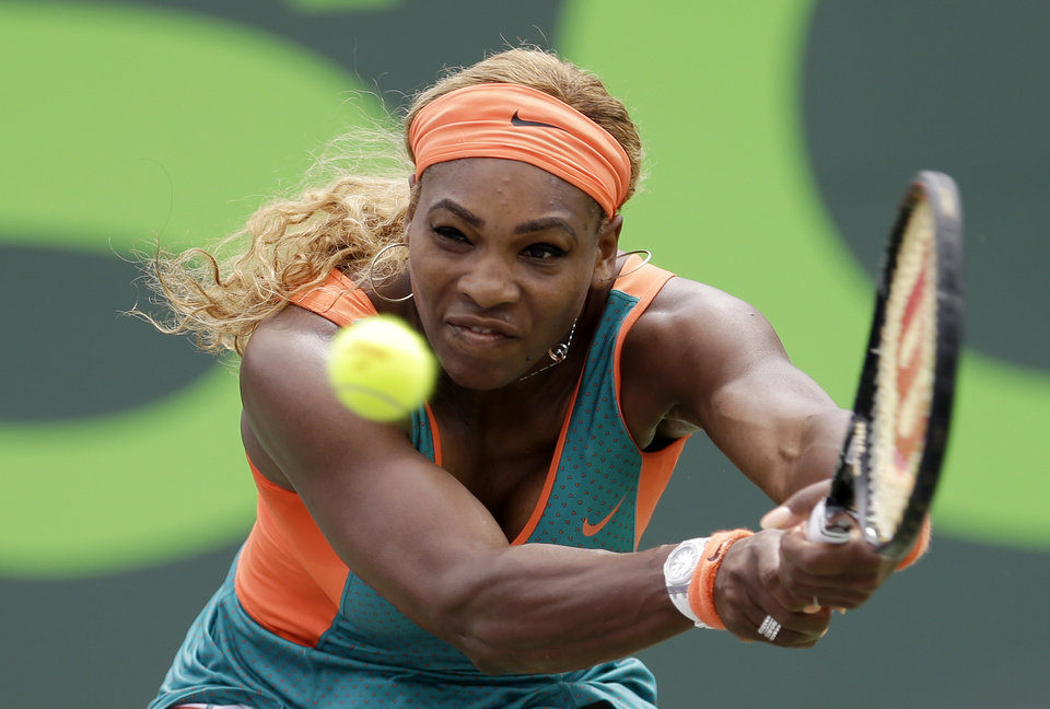 Photo - Serena Williams, of the United States, returns to Li Na, of China, during the women's final at the Sony Open Tennis tournament in Key Biscayne, Fla., Saturday, March 29, 2014. (AP Photo/Alan Diaz)