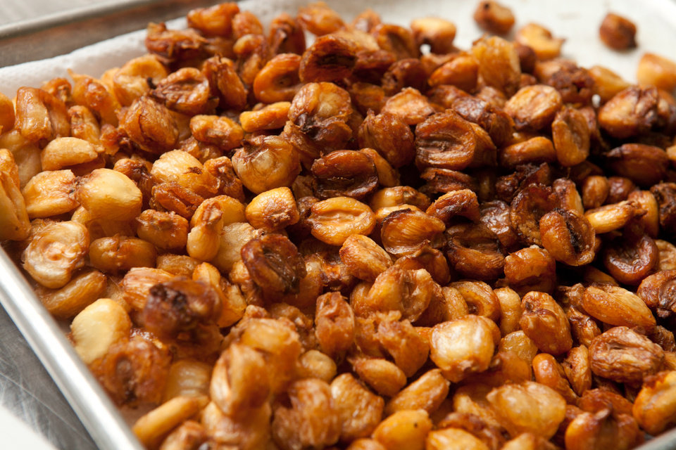 Photo - Popcorn is a centuries-old simple food that has gone gourmet. Though technicallly not popcorn, dried hominy is soaked, fried and sprinked with chili-spice. (Renne Brock/Atlanta Journal-Constitution/MCT)