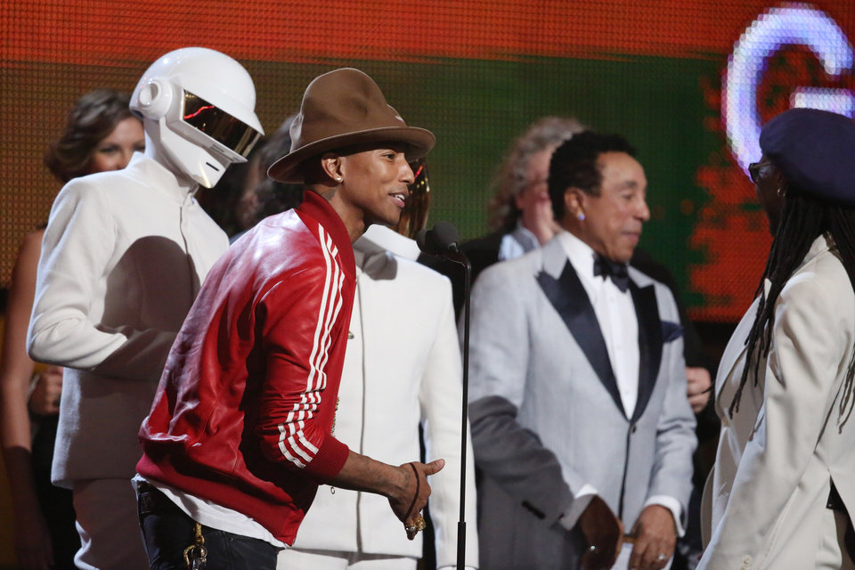 Photo - Pharrell Williams, second from left, and Daft Punk accept the award for record of the year at the 56th annual Grammy Awards at Staples Center on Sunday, Jan. 26, 2014, in Los Angeles. (Photo by Matt Sayles/Invision/AP)