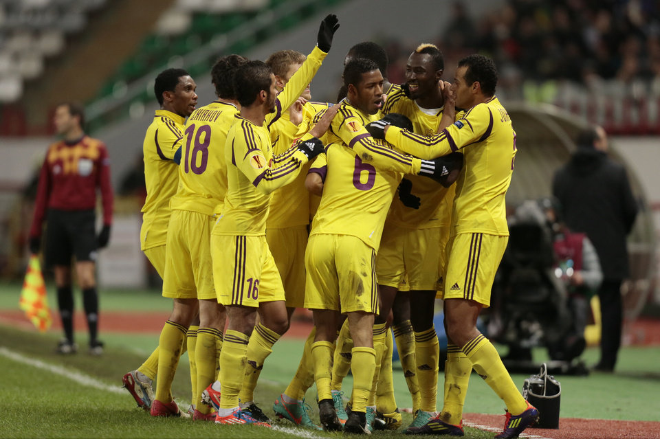 Anzhi's Lacina Traore, 2nd right, celebrates his goal against Liverpool with teammates during the Europa League Group A soccer match at Lokomotiv stadium in Moscow, Russia, on Thursday, Nov. 8, 2012. Anzhi won 1-0. (AP Photo/Ivan Sekretarev)