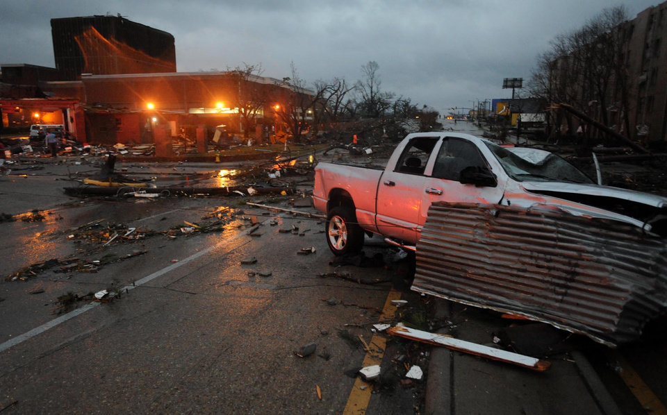 A heavily damaged vehicle sits near the front of the University of Southern Mississippi on Hardy Street in Hattiesburg Miss., Feb 10, 2013 after a tornado passed through the city Sunday afternoon. (AP Photo/Hattiesburg American, Ryan Moore)