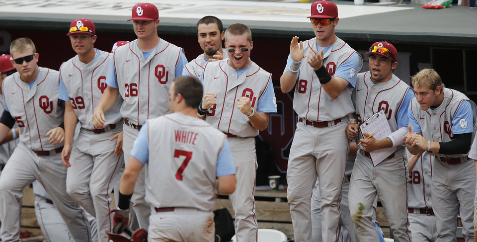 The Sooner dugout reacts as Max White (7) returns to the dugout after scoring a run in the Big 12 Championship baseball game between the University of Kansas Jayhawks (KU) and the University of Oklahoma Sooners (OU) at the Chickasaw Bircktown Ballpark on Sunday, May 26, 2013 in Oklahoma City, Okla. Photo by Chris Landsberger, The Oklahoman