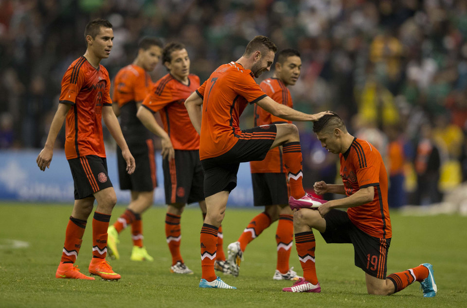 Photo - Mexicol's Miguel Layun celebrates with teammates after scoring during a friendly soccer match against Israel, in Mexico City, Wednesday, May 28, 2014. (AP Photo/Eduardo Verdugo)