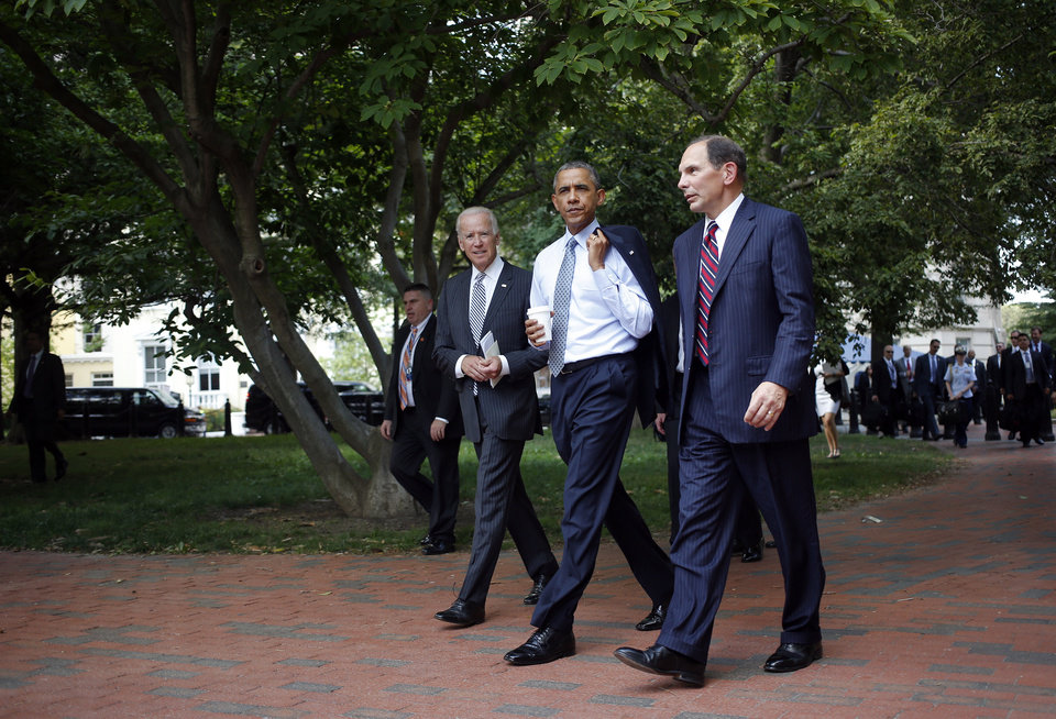 Photo - President Barack Obama and Vice President Joe Biden walk with  Procter and Gamble executive Robert McDonald, Obama's nominee as the next Veterans Affairs secretary, from the Department of Veterans Affairs across Lafayette Park back to the White House in Washington, Monday, June 30, 2014. If confirmed by the Senate, McDonald would succeed Eric Shinseki, the retired four-star general who resigned last month as the scope of the issues at veterans' hospitals became apparent. (AP Photo/Charles Dharapak)
