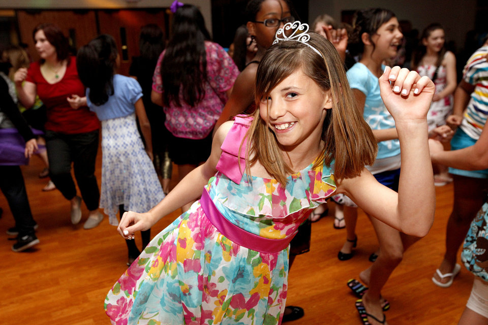 Abigail Lynch dances during the Midwest City Parks and Recreation's Spring Fling dance in Midwest City, Okla., Friday, March 16, 2012. Photo by Sarah Phipps, The Oklahoman.