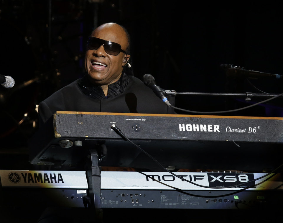 Photo - Singer Stevie Wonder performs during the Inaugural Ball at the 57th Presidential Inauguration in Washington, Monday, Jan. 21, 2013. (AP Photo/Paul Sancya)